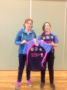 Deidre Hughes presenting Leanne Ryan (2nd Year) with the No. 14 jersey, the jersey that Deirdre wore with such pride and success during her camogie career.